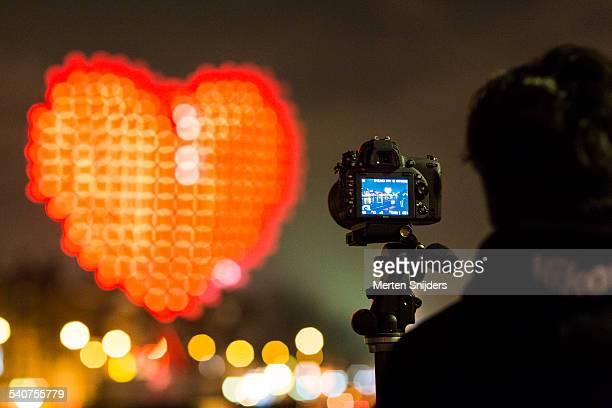 Photographer framing heart shaped installation