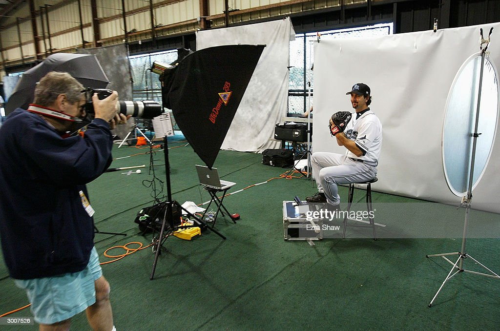 Photographer Gene Boyars takes a picture of Paul Abbott during the Tampa Bay Devil Rays photo day on February 23 2004 at the Devil Rays spring...
