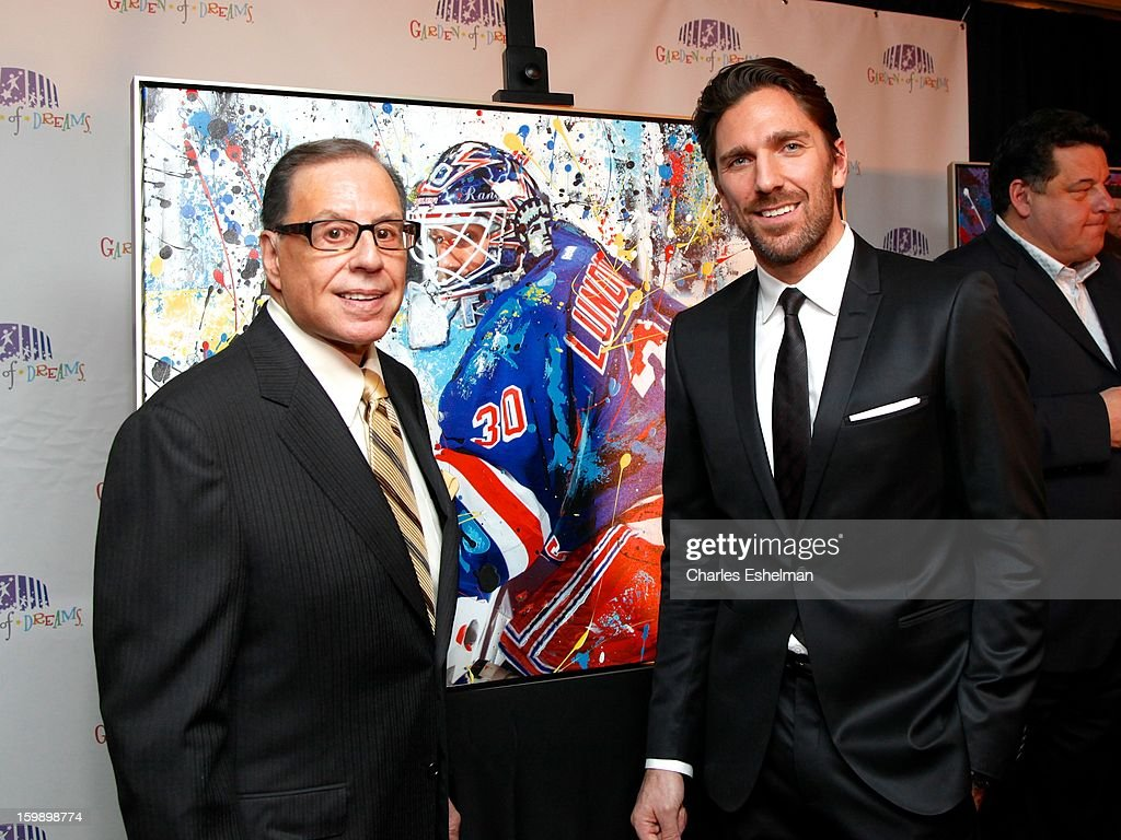 Photographer George Kalinsky and New York Rangers goaltender <a gi-track='captionPersonalityLinkClicked' href=/galleries/search?phrase=Henrik+Lundqvist&family=editorial&specificpeople=217958 ng-click='$event.stopPropagation()'>Henrik Lundqvist</a> attend the Garden of Dreams Foundation press conference at Madison Square Garden on January 22, 2013 in New York City.