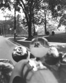 A photographer gets a photograph of the street both coming and going with this shot in the side mirror of a parked car Bridgeport Connecticut mid...