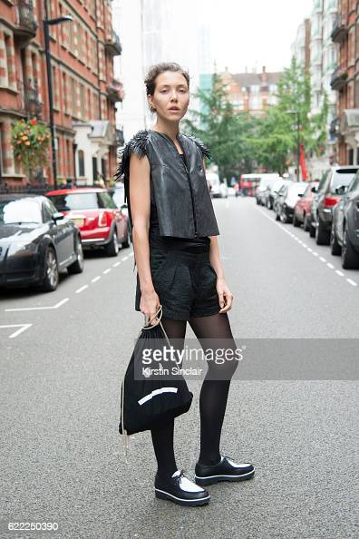 Photographer Hana Knizova wears a Thereza Kladosova waistcoat Svetlana Fialova bag Zara shorts top and shoes day 4 of London Womens Fashion Week...