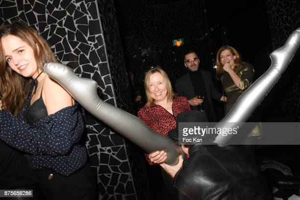 Photographer Hannibal Volkoff plays with the legs of a ruber doll during 'Le Temps Retrouve' Party at Les Bains on November 17 2017 in Paris France
