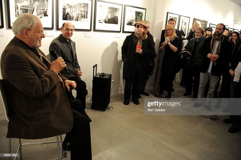 Photographer Henry Grossman (L) and CMO of Rock Paper Photo Ed Baum (2L) attend The Beatles 50 Year Commemorative Anniversary photo exhibit at Rock Paper Photo NYC Pop Up Gallery on February 4, 2014 in New York City.