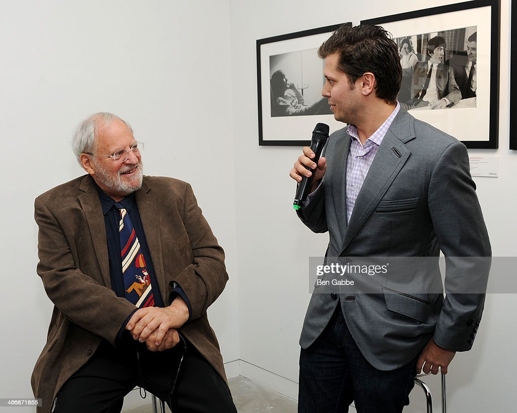 Photographer Henry Grossman (L) and Vlad Ginsberg attend The Beatles 50 Year Commemorative Anniversary photo exhibit at Rock Paper Photo NYC Pop Up Gallery on February 4, 2014 in New York City.