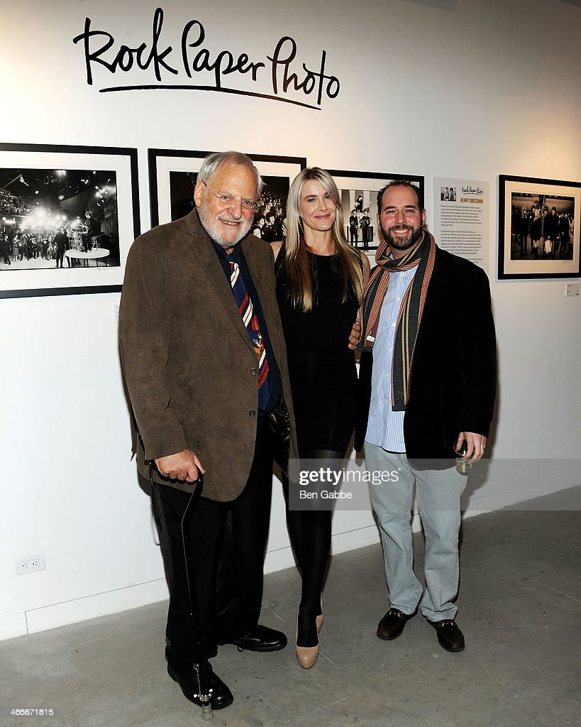 Photographer Henry Grossman, Jody Britt and Mark Halpern attend The Beatles 50 Year Commemorative Anniversary photo exhibit at Rock Paper Photo NYC Pop Up Gallery on February 4, 2014 in New York City.