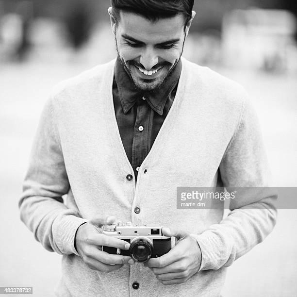 Photographer holding a vintage camera