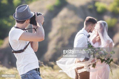 Fotógrafo en acción  : Foto de stock