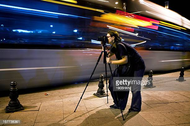 Photographer in traffic