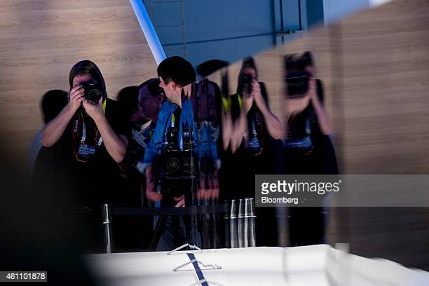 A photographer is seen reflected on a Sony Corp 4K ultra thin televisions during the 2015 Consumer Electronics Show in Las Vegas Nevada US on Tuesday...