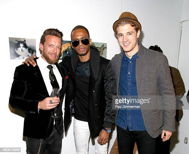 Photographer Jamie McCarthy actor Eric West and Pasha Pellosie attend a pet portrait exhibition by Getty Images staff photographer Jamie McCarthy to...