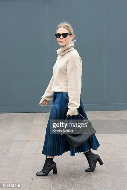 Photographer Jess Bush wears a Filippa K top Cedric Charlier skirt Senso boots Loewe bag and Celine sunglasses on day 3 during London Fashion Week...