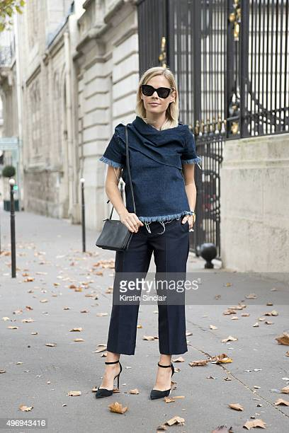 Photographer Jess Bush wears Celine sunglasses and bag Marques Almeida top Acne trousers and Alexandre Birman shoes on day 6 during Paris Fashion...