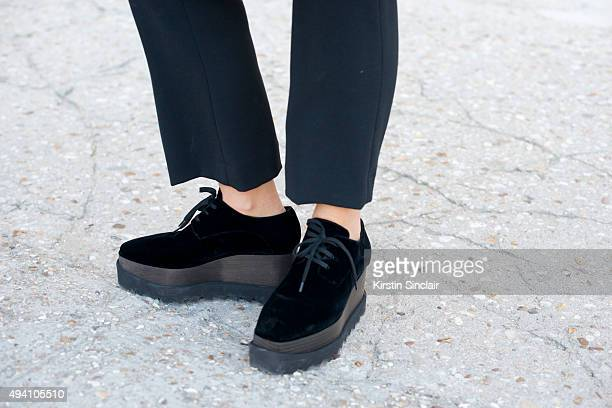 Photographer Jess Bush wears MSGM trousers and Stella McCartney shoes on day 3 during Paris Fashion Week Spring/Summer 2016/17 on October 1 2015 in...