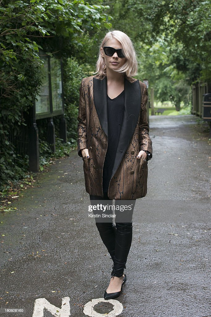 Photographer Jessie Bush wears Isa Tapia shoes, Watson and Watson trousers, T by Aexander Wang vest, Zimmerman blazer and Nick Campbell sunglasses on day 5 of London Fashion Week Spring/Summer 2013, at Somerset House on September 17, 2013 in London, England.