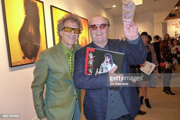 Photographer Jimmy Steinfeldt and Jack Nicholson pose for a portrait at the Taschen Gallery celebrating the photographs of The Rolling Stones and...
