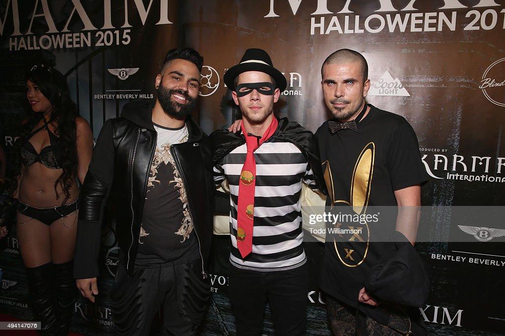 Photographer Joel Alvarez, recording artist Nick Jonas and Mistertriplex attend the Maxim Halloween Party Presented By Karma International on October 24, 2015 in Los Angeles, California.