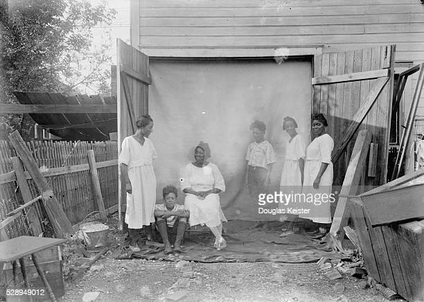 Photographer John Johnson used the big double doors of an outbuildingperhaps the frame barn he built in his back yard in 1908to frame this image in...