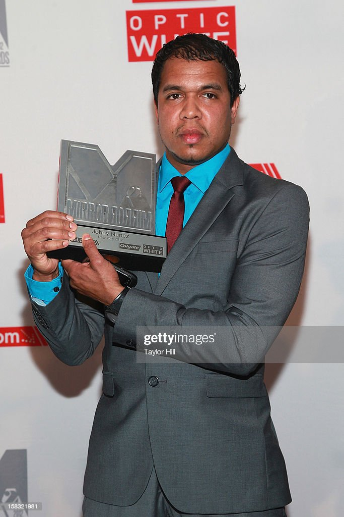 Photographer <a gi-track='captionPersonalityLinkClicked' href=/galleries/search?phrase=Johnny+Nunez+-+Photographer&family=editorial&specificpeople=4388578 ng-click='$event.stopPropagation()'>Johnny Nunez</a> accepts his award at the 2012 Mirror Mirror Awards at The Union Square Ballroom on December 12, 2012 in New York City.