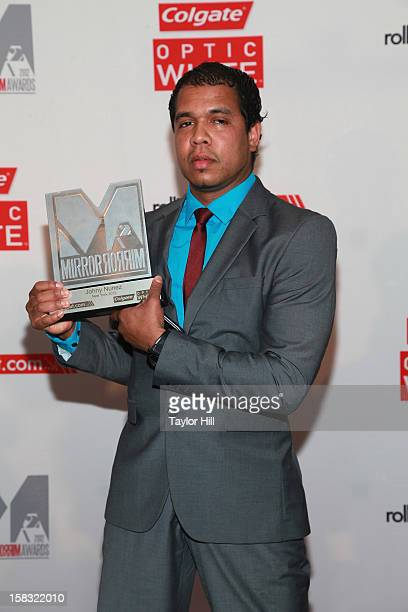 Photographer Johnny Nunez accepts his award at the 2012 Mirror Mirror Awards at The Union Square Ballroom on December 12 2012 in New York City