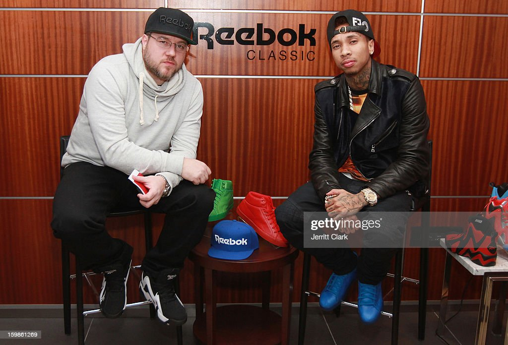 Photographer Jonathan Mannion interviews Tyga at the Reebok Suite during the Brooklyn Nets vs. New York Knicks game at Madison Square Garden on January 21, 2013 in New York City.