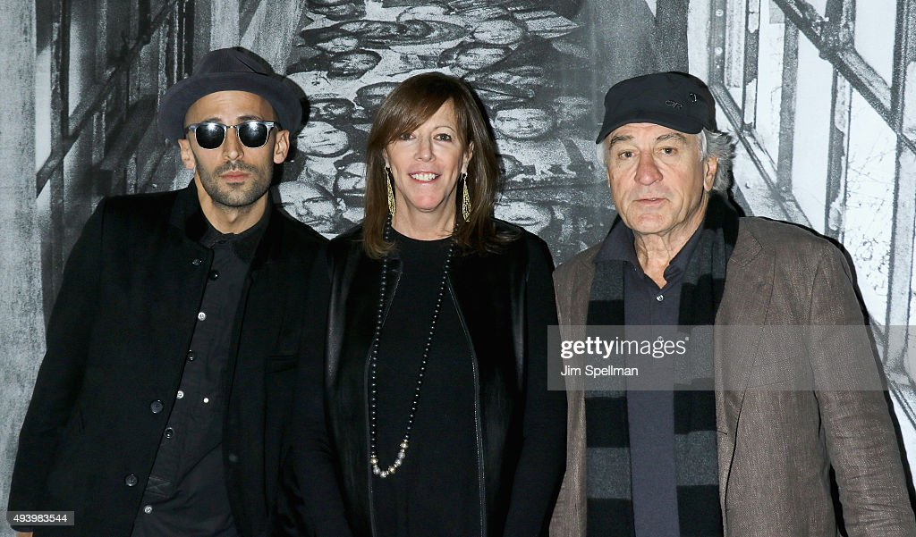 Photographer JR producer Jane Rosenthal and actor Robert De Niro attend the 'Ellis' New York premiere on October 23 2015 in New York City