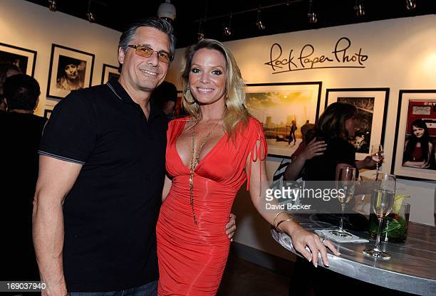 Photographer Kevin Mazur and his wife Jennifer Mazur appear at the Rock Paper Photo gallery inside the Hard Rock Hotel Casino on May 18 2013 in Las...