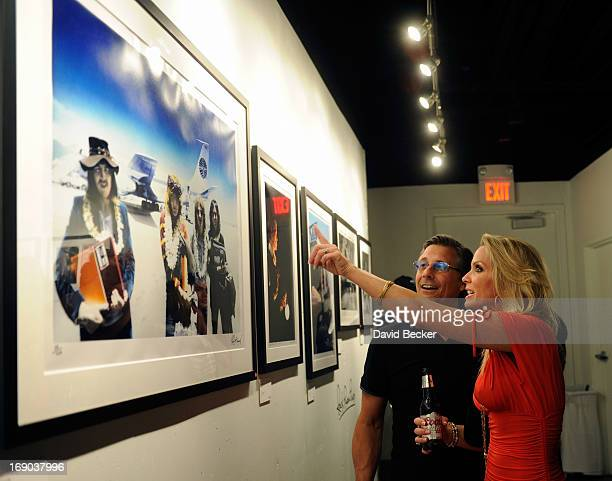 Photographer Kevin Mazur and his wife Jennifer Mazur appear at the grand opening of the Rock Paper Photo gallery inside the Hard Rock Hotel Casino on...