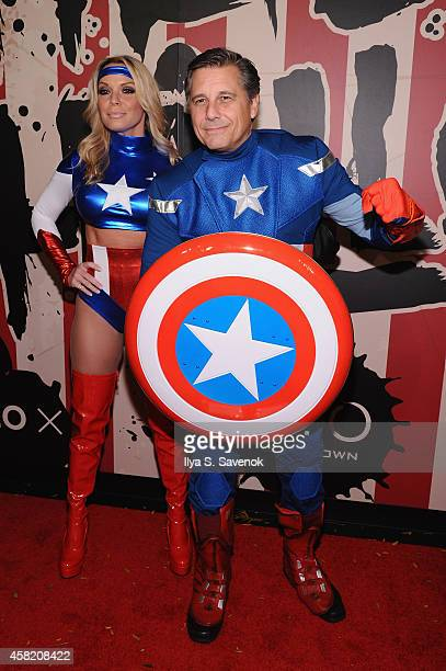 Photographer Kevin Mazur and Jennifer Mazur attend Moto X presents Heidi Klum's 15th Annual Halloween Party sponsored by SVEDKA Vodka at TAO Downtown...