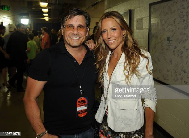 Photographer Kevin Mazur and musician Sheryl Crow attend the 2011 CMT Music Awards at the Bridgestone Arena on June 8 2011 in Nashville Tennessee