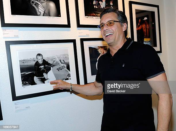 Photographer Kevin Mazur attends the grand opening of the Rock Paper Photo gallery inside the Hard Rock Hotel Casino on May 18 2013 in Las Vegas...