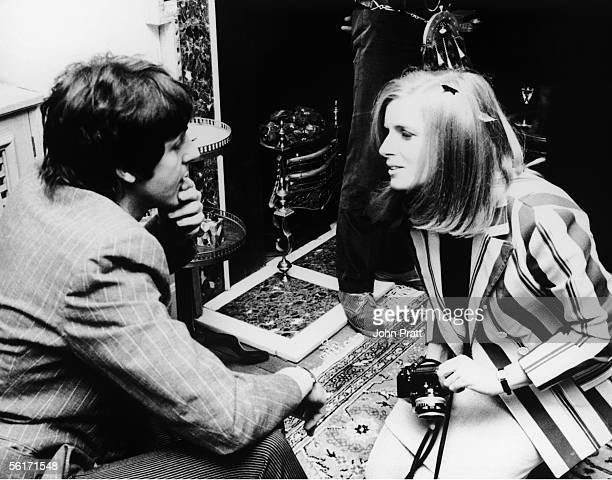 Photographer Linda Eastman talks to Beatle Paul McCartney at the press launch of the Beatles new album 'Sgt Pepper's Lonely Hearts Club Band' 19th...