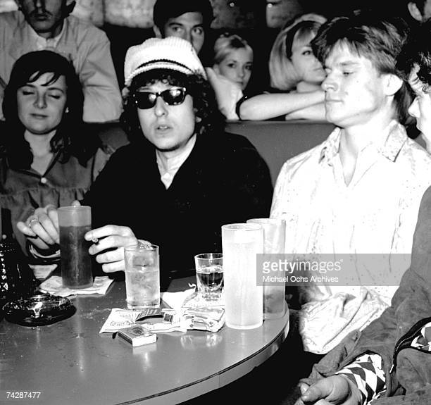 Photographer Lisa Law Bob Dylan and music manager Tom Law hang out at the Whisky AGoGo on a night off in circa 1966 in Los Angeles California This is...