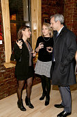 Photographer Lynsey Addario Katie Couric and John Molner attend the Lynsey Addario's Book Launch Party 'It's What I Do' on February 6 2015 in New...