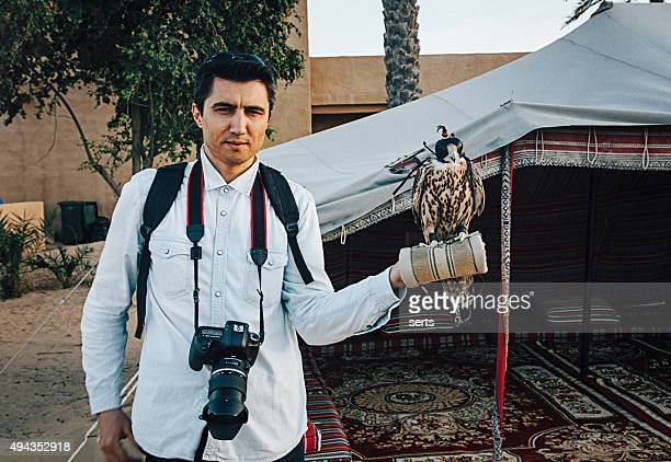 Photographer man with falcon