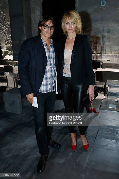 Photographer Mario Sorrenti and model Amber Valletta attend the Saint Laurent show as part of the Paris Fashion Week Womenswear Spring/Summer 2017 on...