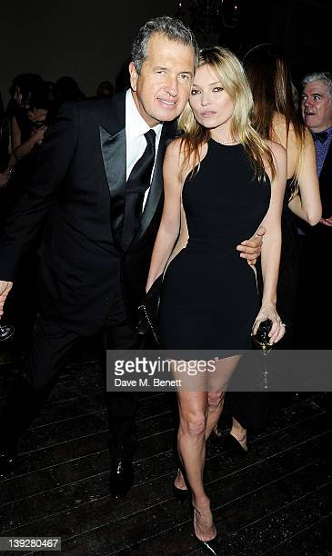 Photographer Mario Testino and Kate Moss attend a cocktail reception at the Stella McCartney Special Presentation during London Fashion Week...