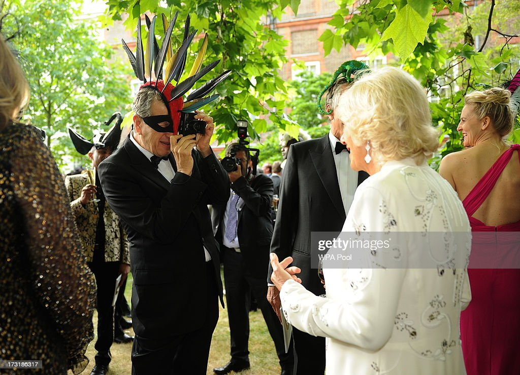 Photographer Mario Testino photographs Camilla, Duchess of Cornwall as Prince Charles, Prince of Wales and Camilla, Duchess of Cornwall host a reception for the Elephant Family, a charity working to save the Asian Elephant from extinction in the wild, at Clarence House on July 09, 2013 in London, England.