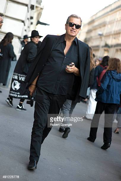 Photographer Mario Testino wears all black suit after Acne at Hotel Potocki during Paris Fashion Week Spring/Summer 16 on October 3 2015 in Paris...