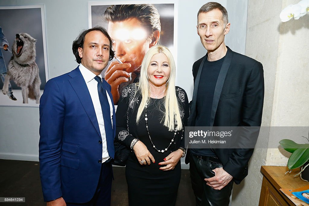 Photographer Markus Klinko (R) attends his exhibition opening with <a gi-track='captionPersonalityLinkClicked' href=/galleries/search?phrase=Monika+Bacardi&family=editorial&specificpeople=4456413 ng-click='$event.stopPropagation()'>Monika Bacardi</a> and David Swaelens Kane at Artcube Galery on May 26, 2016 in Paris, France.