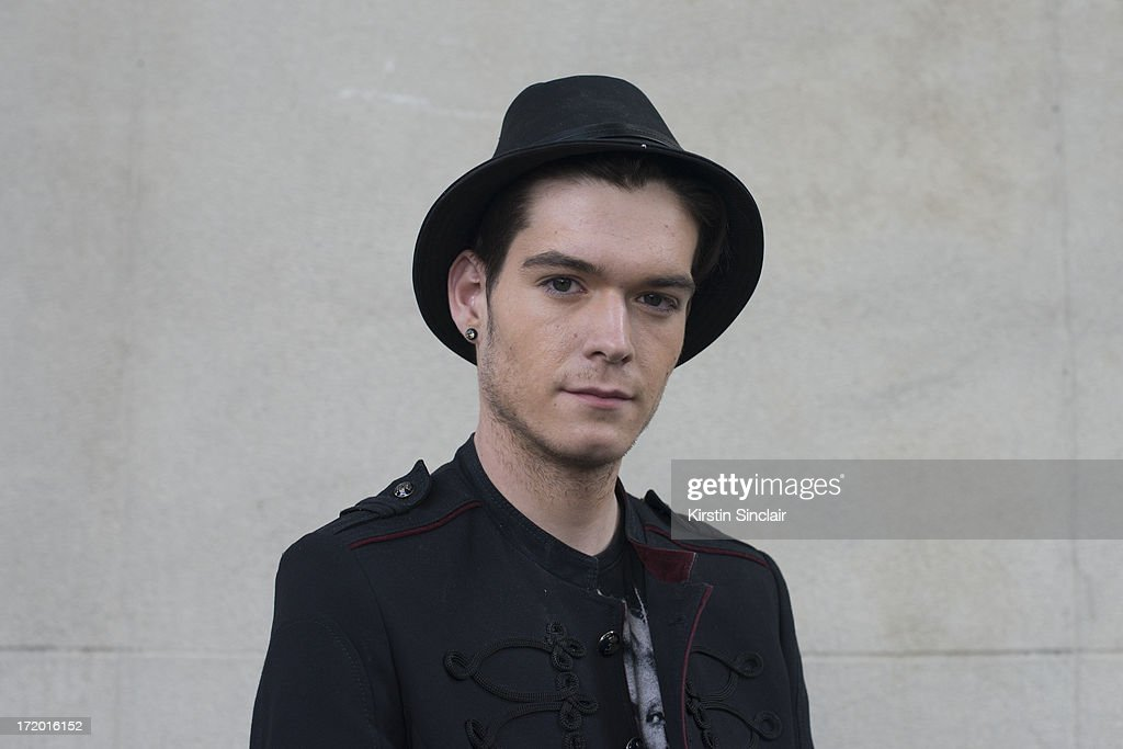 Photographer Martijn Cremers wears a Zara jacket, Jack and Jones t-shirt and a Burberry hat on day 4 of Paris Collections: Men on June 29, 2013 in Paris, France.