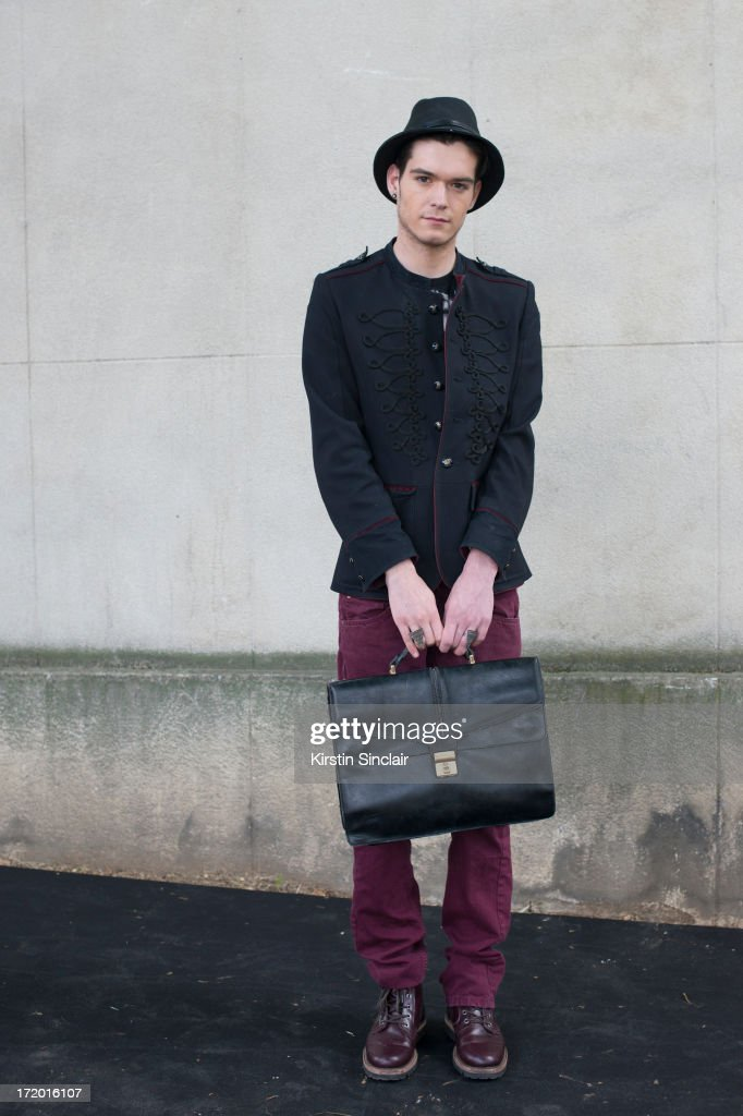 Photographer Martijn Cremers wears H and M shoes and jeans, vintage bag, Zara jacket, Jack and Jones t-shirt and a Burberry hat on day 4 of Paris Collections: Men on June 29, 2013 in Paris, France.