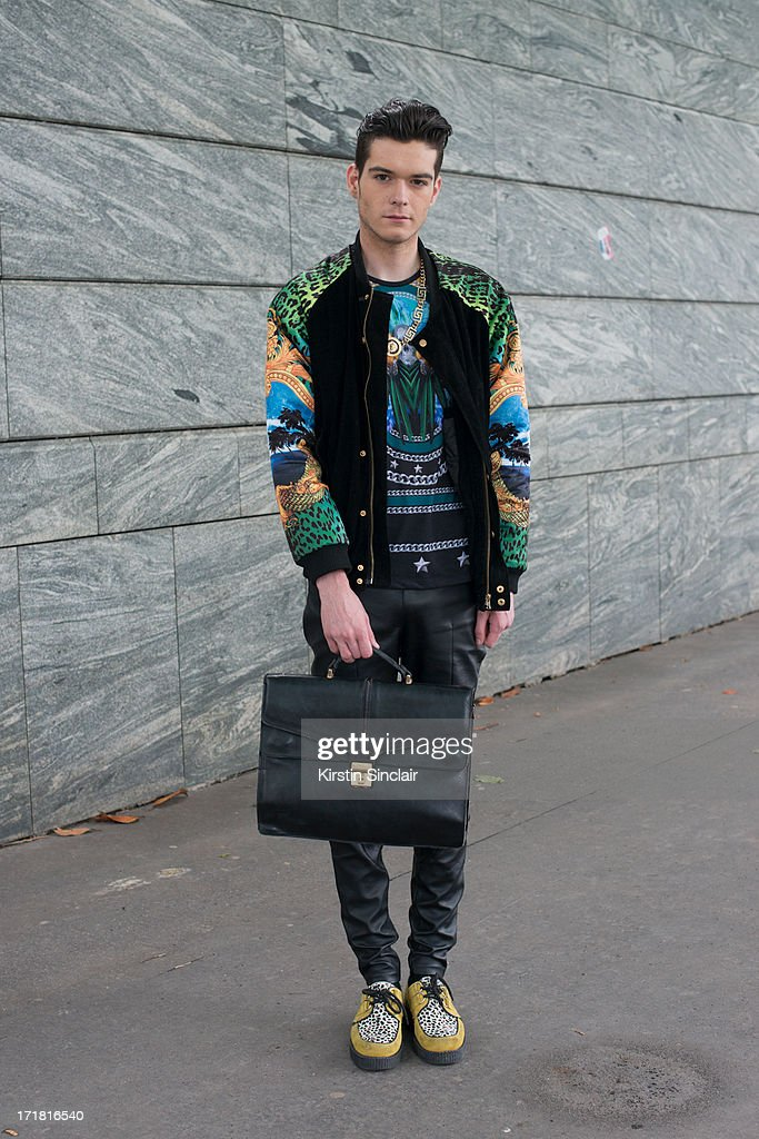 Photographer Martijn Cremers wears Underground Creepers, Zara trousers and t-shirt, Versace for H and M jacket, Vintage bag and a necklace from Amsterdam on day 3 of Paris Collections: Men on June 28, 2013 in Paris, France.