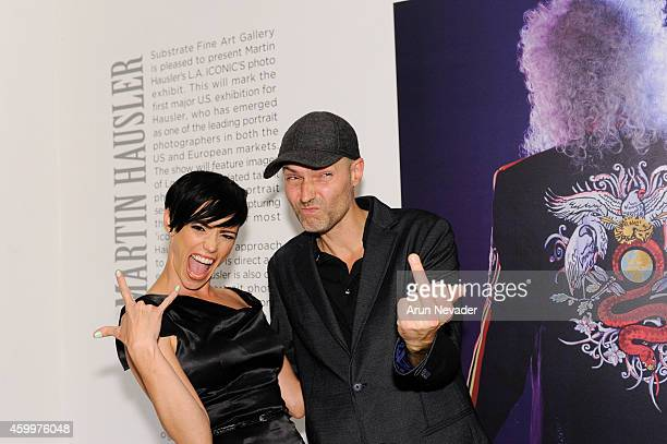 Photographer Martin Hausler and singer Jessica Sutta appear at the opening reception for the photographic works of Martin Hausler at Substrate Fine...
