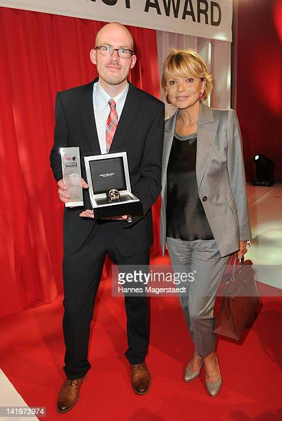 Photographer Martin Schlueter and actress Uschi Glas attend the CNN Journalist Award 2012 at the GOP Variete Theater on March 27 2012 in Munich...