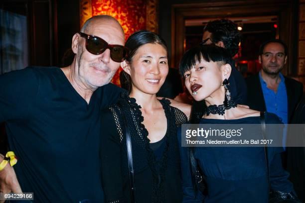 Photographer Michel Comte Ayako Yoshida and Aya Sato attend the Life Ball 2017 reception at Palais Szechenyi on June 9 2017 in Vienna Austria The...