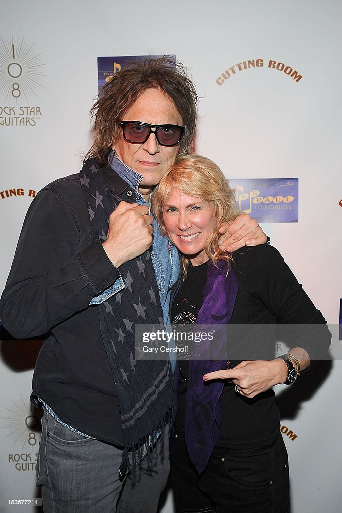 Photographer <a gi-track='captionPersonalityLinkClicked' href=/galleries/search?phrase=Mick+Rock&family=editorial&specificpeople=236042 ng-click='$event.stopPropagation()'>Mick Rock</a> (L) and author and photographer Lisa Johnson attend the book launch and performance for '108 Rock Star Guitars' benefitting The Les Paul Foundation at The Cutting Room on October 8, 2013 in New York City.