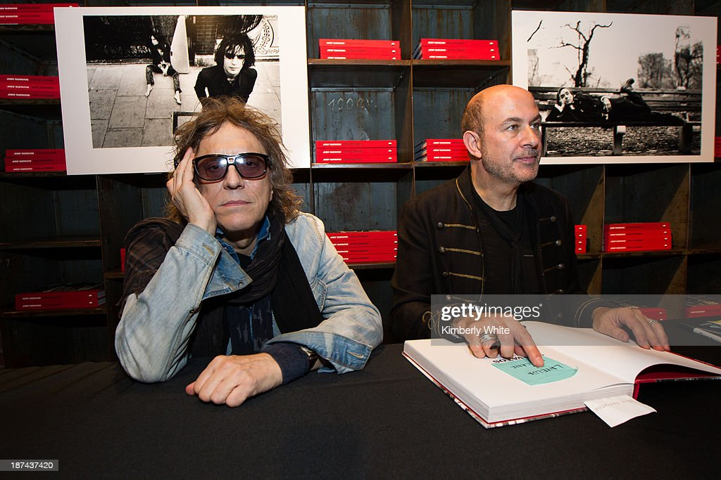 Photographer Mick Rock (L) and fashion designer John Varvatos sign books at the launch of the book 'Rock In Fashion' at John Varvatos on November 8, 2013 in San Francisco, California.