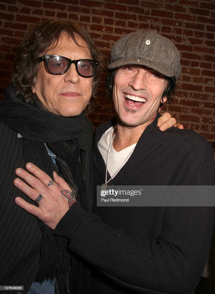 Photographer Mick Rock and musician Tommy Lee attend the 'Mick Rock: Exposed' exhibition and opening night reception at Confederacy on December 16, 2010 in Los Angeles, California.
