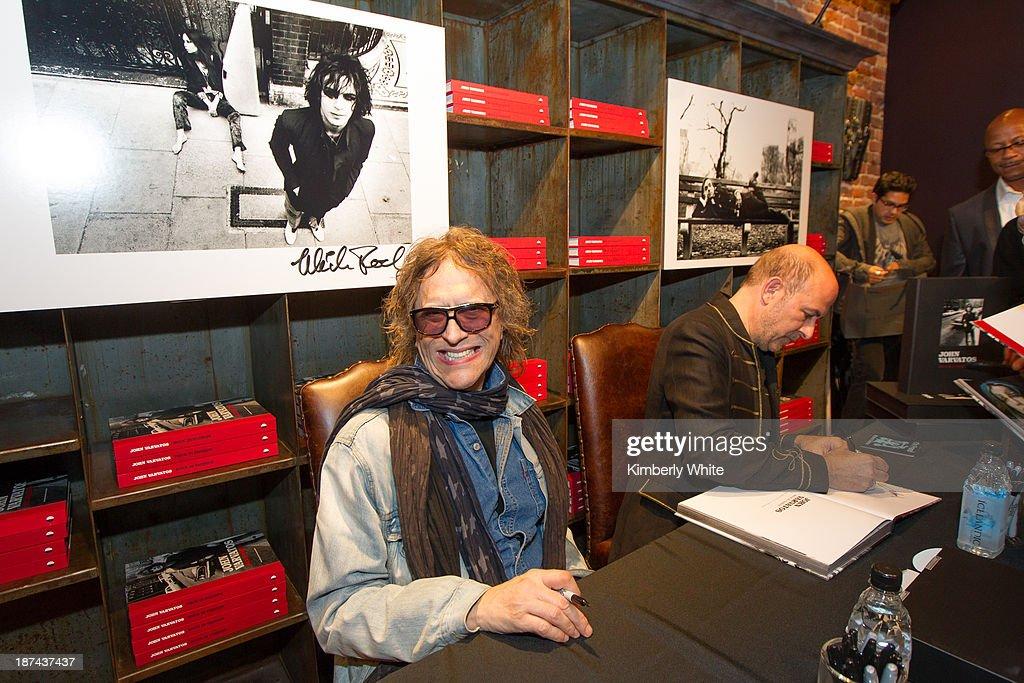 Photographer Mick Rock (L) smiles next to fashion designer John Varvatos at the launch of the book 'Rock In Fashion' at John Varvatos on November 8, 2013 in San Francisco, California.