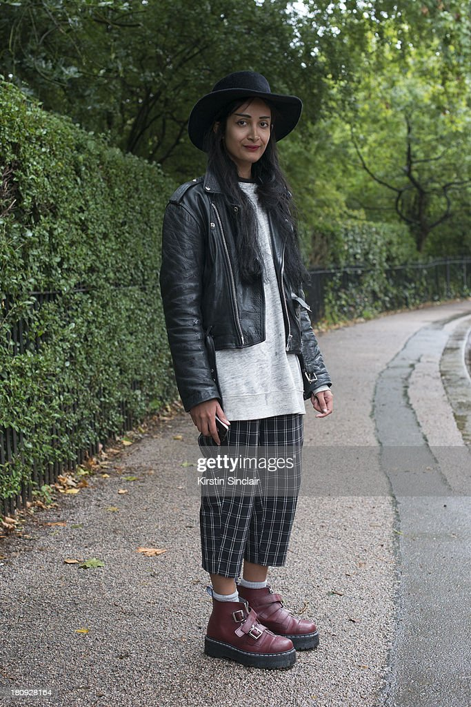 Photographer Nadia Sarwar wears Doc Martin's shoes, Gigi Burris hat, vintage trousers and jacket and H and M sweater on day 5 of London Fashion Week Spring/Summer 2013, at Somerset House on September 17, 2013 in London, England.